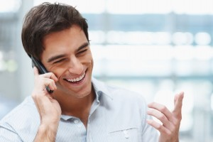 Laughing businessman having conference call